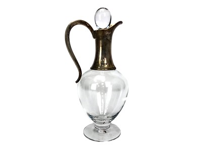 Lot 436 - A SILVER COLLARED CLARET JUG AND STOPPER