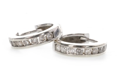 Lot 809 - A PAIR OF DIAMOND SET HOOP EARRINGS