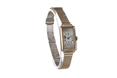 Lot 705 - A LADY'S GENEX NINE CARAT GOLD MANUAL WIND WRIST WATCH