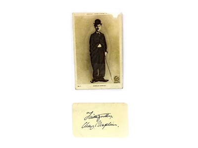 Lot 1317-AN AUTOGRAPH ALBUM PAGE SIGNED BY CHARLIE CHAPLIN AND ANOTHER
