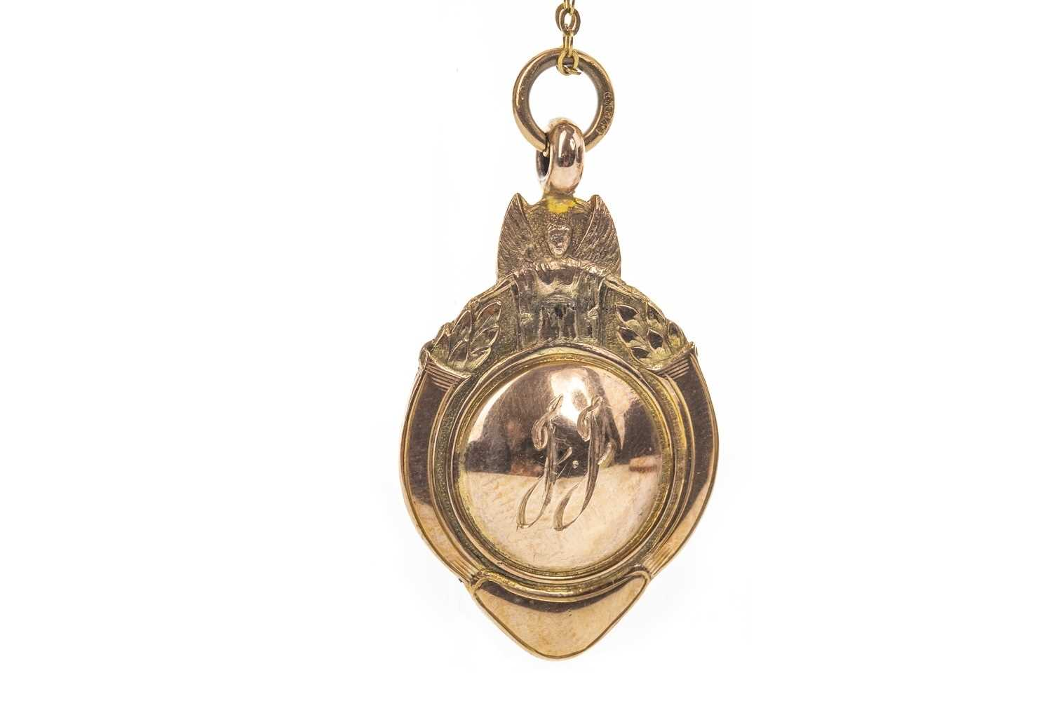 Lot 1724 - AN EARLY 20TH CENTURY NINE CARAT GOLD FOB MEDAL
