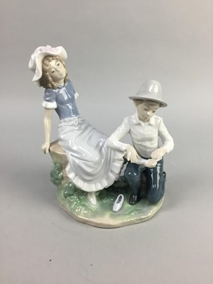 Lot 12-A NAO FIGURE GROUP OF TWO CHILDREN