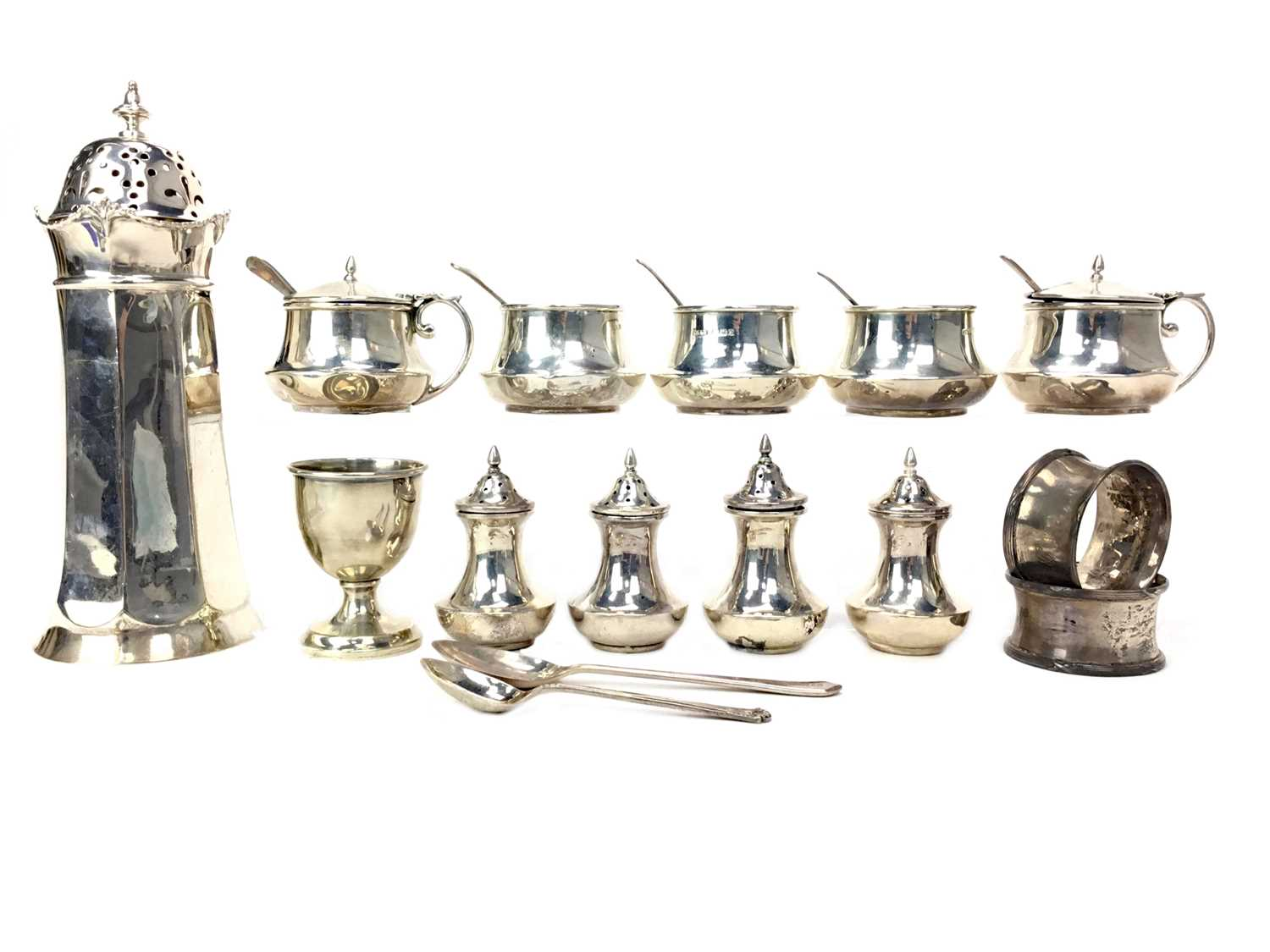 Lot 425 - A LOT OF SILVER CONDIMENT JARS, SHAKERS AND NAPKIN RINGS