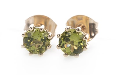 Lot 850 - A PAIR OF PERIDOT EARRINGS