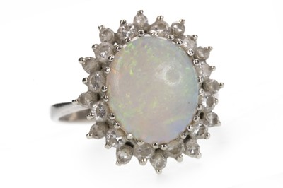 Lot 852 - AN OPAL AND DIAMOND RING