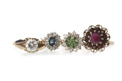 Lot 858 - FOUR GEM SET RINGS