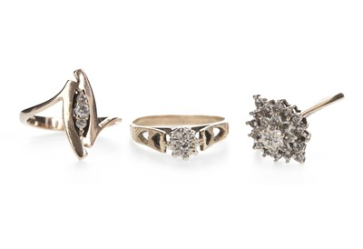 Lot 859 - TWO DIAMOND RINGS AND A WHITE GEM SET RING