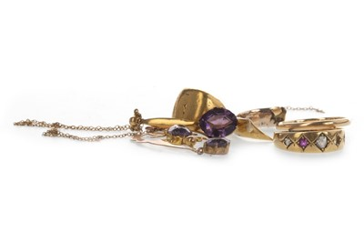 Lot 873 - TWO PURPLE GEM SET PENDANTS AND THREE RINGS