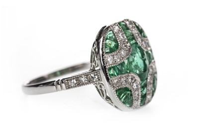 Lot 884-AN EMERALD AND DIAMOND RING