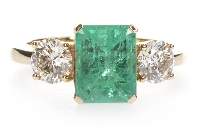 Lot 889 - AN EMERALD AND DIAMOND THREE STONE RING