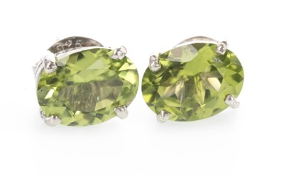 Lot 894 - A PAIR OF PERIDOT STUD EARRINGS