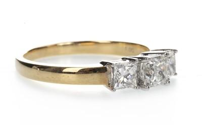 Lot 907-A DIAMOND THREE STONE RING