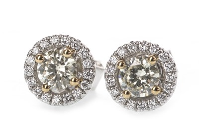Lot 912 - A PAIR OF YELLOW AND WHITE DIAMOND EARRINGS