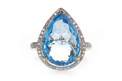 Lot 875-A BLUE TOPAZ AND DIAMOND RING