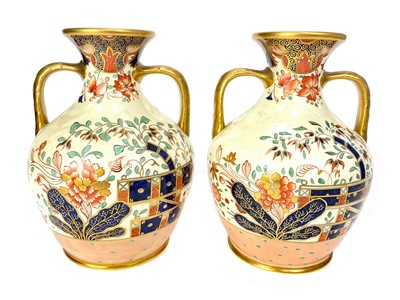 Lot 1025-A PAIR OF LATE VICTORIAN STAFFORDSHIRE IMARI VASES