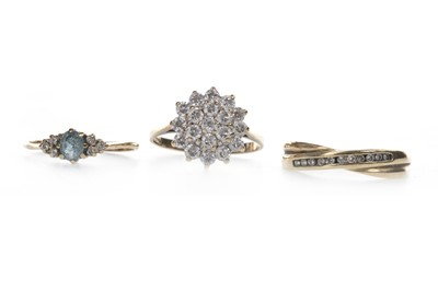 Lot 914 - TWO DIAMOND RINGS AND A GEM SET CLUSTER RING