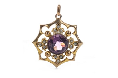 Lot 929-A PURPLE GEM SET AND SEED PEARL PENDANT