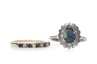 Lot 304-A BLUE GEM SET AND DIAMOND RING AND A CLUSTER RING