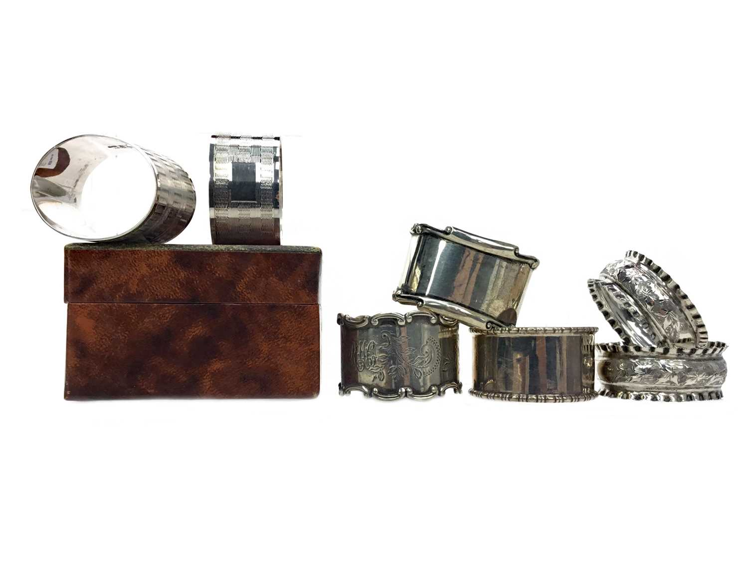 Lot 447 - A BOXED PAIR OF SILVER NAPKIN RINGS AND OTHER SILVER NAPKIN RINGS