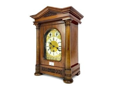 Lot 1165 - A LATE VICTORIAN WALNUT BRACKET CLOCK