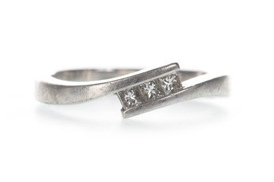 Lot 318-A DIAMOND THREE STONE RING