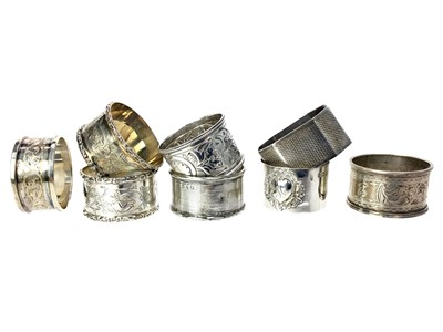 Lot 460 - A LOT OF EIGHT NAPKIN RINGS