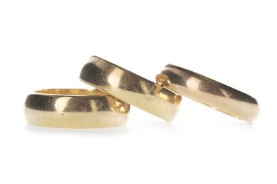 Lot 327-THREE EIGHTEEN CARAT GOLD WEDDING RINGS