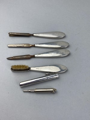 Lot 19-A SILVER HANDLED FOUR PIECE MANICURE SET, PENCIL AND SILVER PENCIL CASING