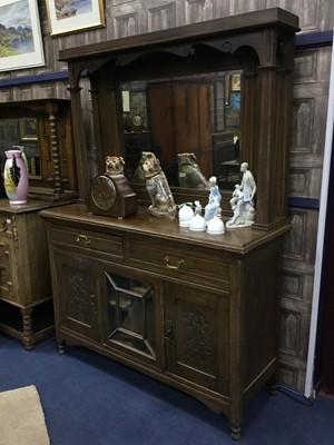 Lot 247 - AN EARLY 20TH CENTURY OAK SIDEBOARD AND A MAHOGANY BOW FRONTED CHEST OF THREE DRAWERS