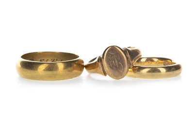 Lot 1303-TWO GOLD WEDDING BANDS AND A SIGNET RING
