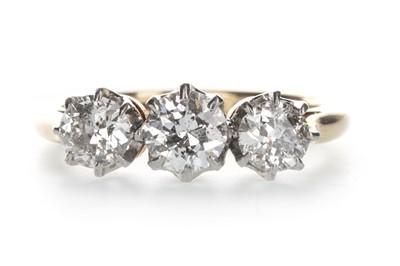 Lot 1308-A DIAMOND THREE STONE RING