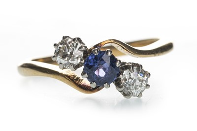 Lot 1309-A BLUE GEM SET AND DIAMOND THREE STONE RING