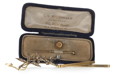 Lot 1313-THREE GOLD BROOCHES AND A DIAMOND SET STICK PIN