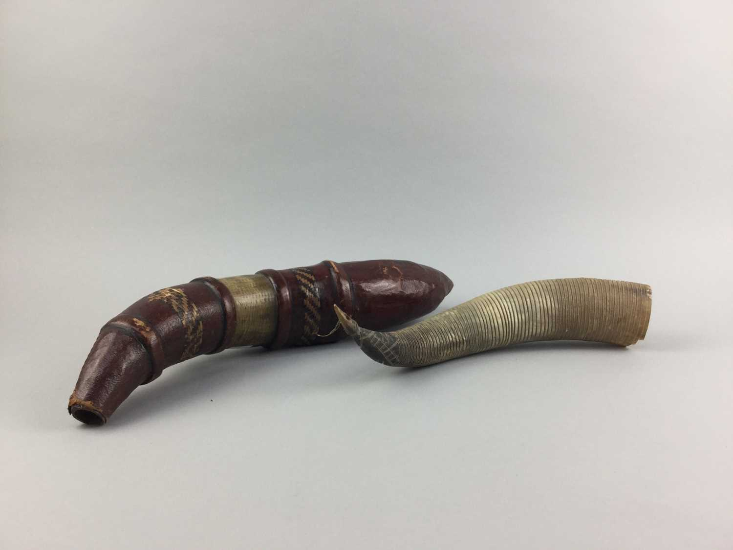 Lot 17-AN AFRICAN LEATHER COVERED POWDER HORN