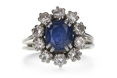 Lot 1331-A BLUE GEM SET AND DIAMOND CLUSTER RING