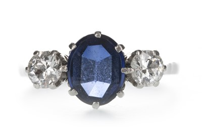 Lot 1329-A BLUE GEM SET AND DIAMOND THREE STONE RING