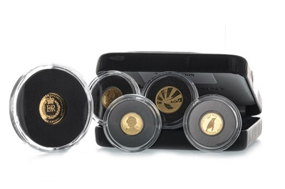 Lot 17-FOUR OF THE SMALLEST GOLD COINS OF THE WORLD AND ONE OTHER