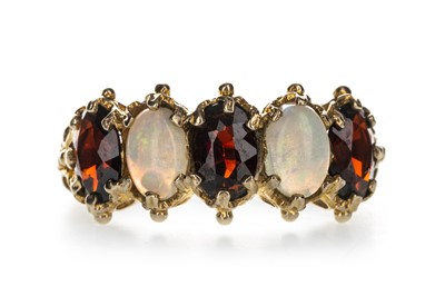 Lot 1338-A RED GEM SET AND OPAL FIVE STONE RING