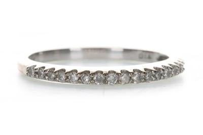 Lot 409 - A DIAMOND HALF ETERNITY RING