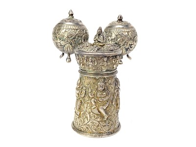 Lot 702-AN INDIAN WHITE METAL PEPPER GRINDER AND A PAIR OF METAL CONDIMENT CASTERS