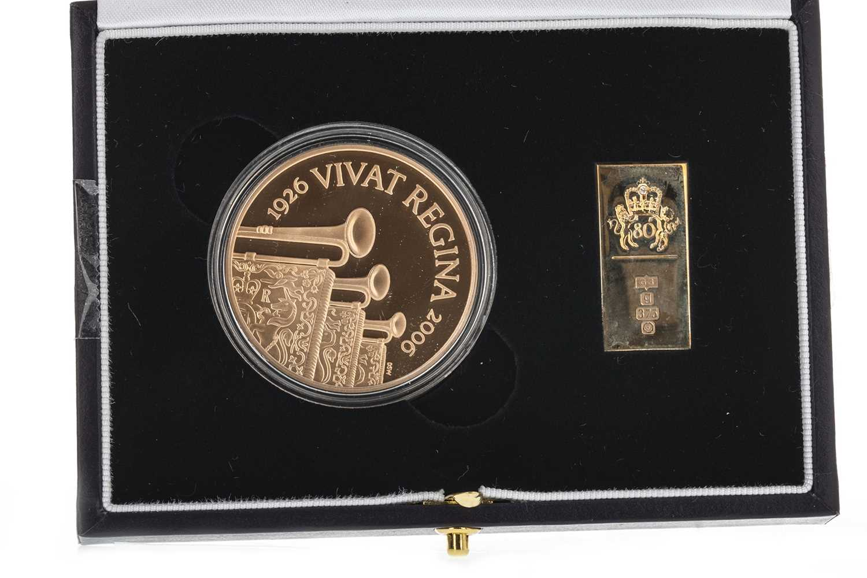Lot 42-THE 2006 QUEEN ELIZABETH II (1952 - PRESENT) EIGHTIETH BIRTHDAY GOLD CROWN AND INGOT SET