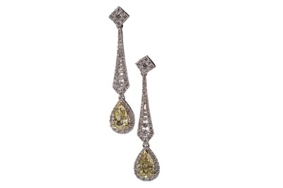 Lot 1330A-A PAIR OF GIA CERTIFICATED FANCY YELLOW DIAMOND EARRINGS