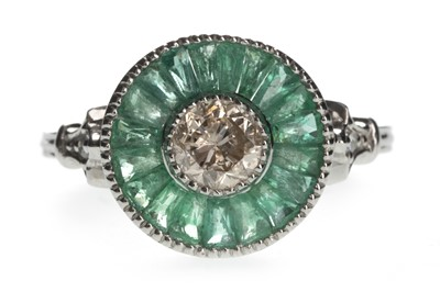 Lot 1410-AN EMERALD AND DIAMOND RING