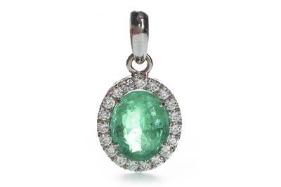 Lot 1427-AN IMPRESSIVE EMERALD AND DIAMOND PENDANT