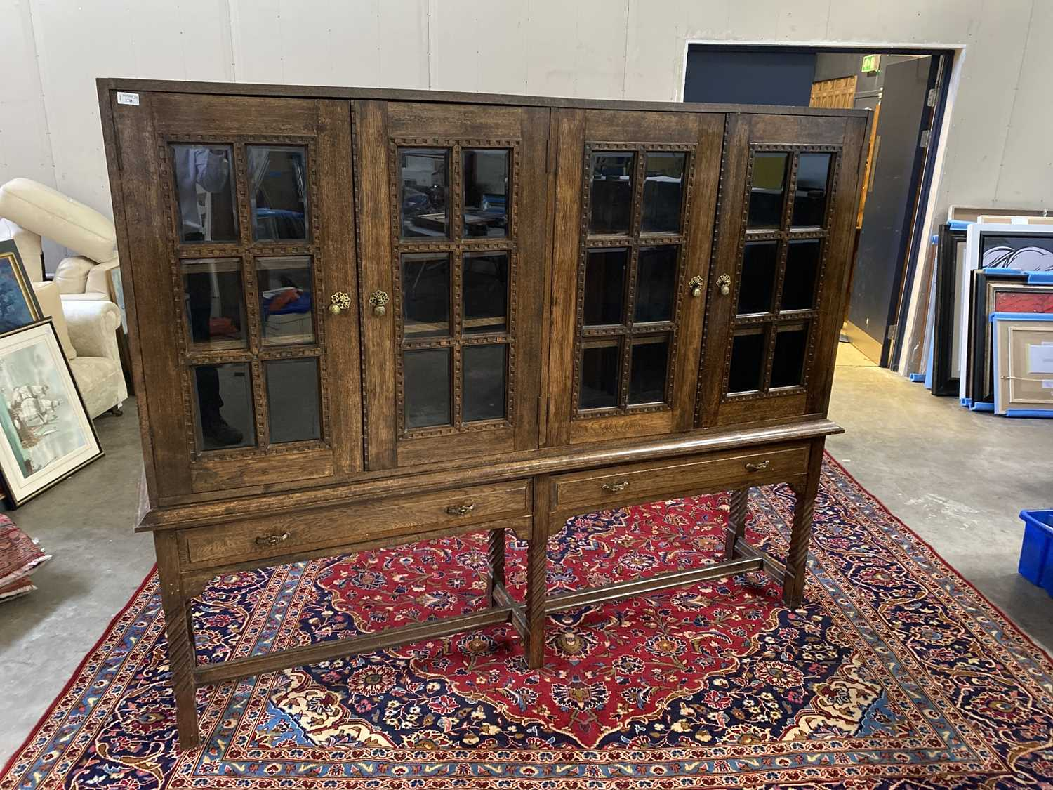 Lot 1711 - AN OAK TWO SECTION BOOKCASE