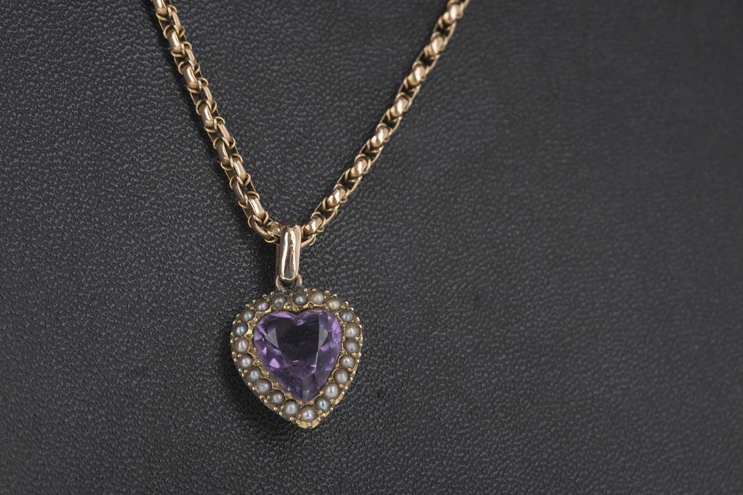 Lot 307-A PURPLE GEM SET AND SEED PEARL PENDANT ON CHAIN