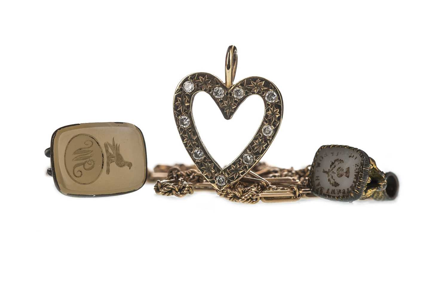 Lot 310-A DIAMOND HEART PENDANT, TWO SEAL FOBS AND A GUARD CHAIN