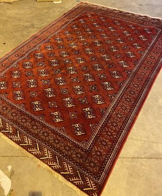 Lot 1307-AN AFGHAN BOKHARA BORDERED CARPET