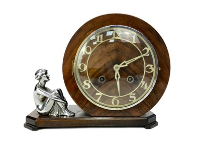 Lot 1123-AN ART DECO MAHOGANY FIGURAL MANTEL CLOCK