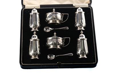 Lot 410 - A GEORGE V SILVER SIX PIECE CRUET SET